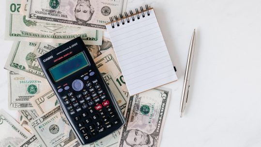 money, calculator, notepad and pen: Blog feature image